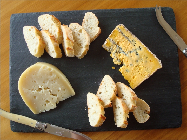 A simple cheeseboard of Cilantro Billy the Kid Goat's Cheddar and Talbot Forest Wiahi Blue.