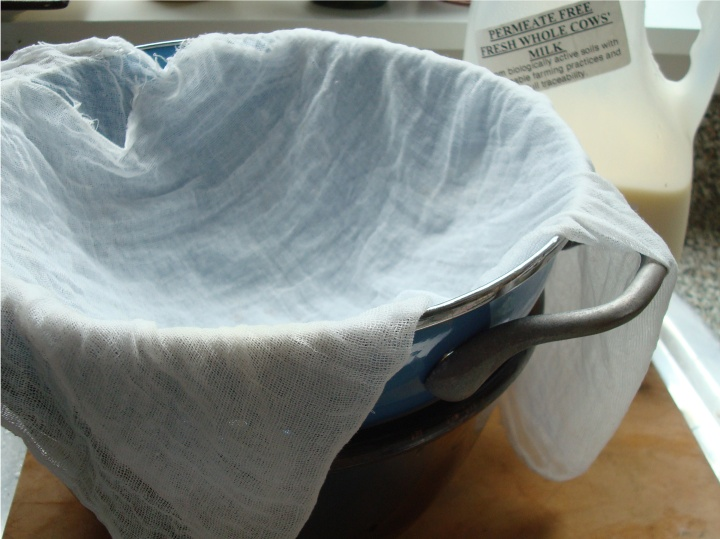A colander with cheesecloth