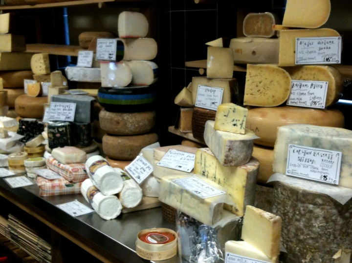 Cheeses sprawl across one wall in their classed in cheese room.